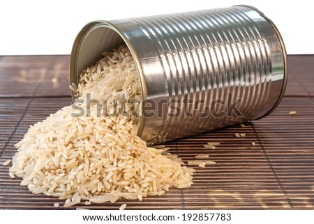 Dry white rice in a silver tin can - stock photo