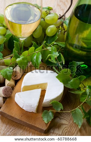 Dry wine, camembert, bottle and glass. Still life. - stock photo