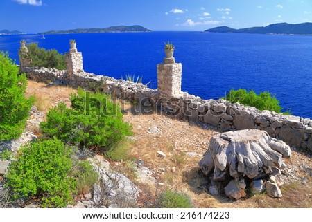 Dry wood on a terrace above the Adriatic sea, Dalmatian coast, Croatia - stock photo