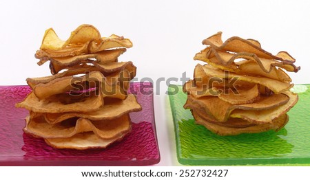 drying apple chips - stock photo