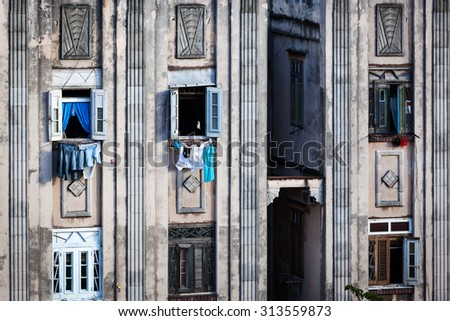 drying clothes in the windows of the old house - stock photo