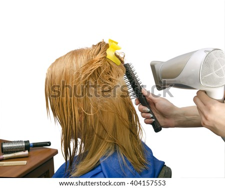 drying of gingers  painted  hair of the hairdryer, white background - stock photo