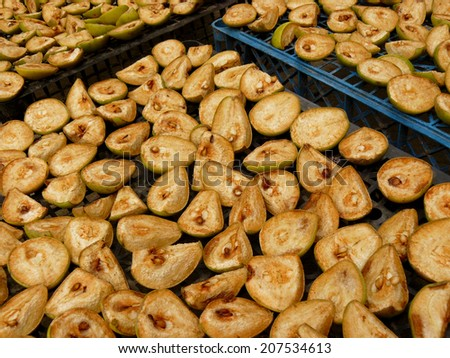 drying of pear slices in home garden - stock photo