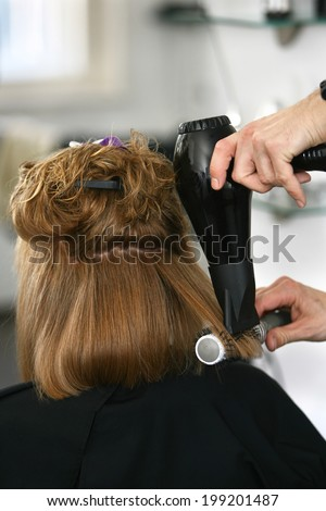Drying the hair with a brush - stock photo