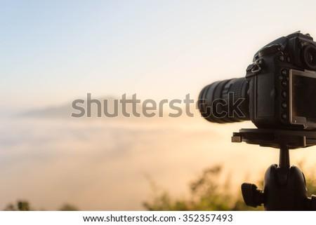 DSLR camera focus on sunrise lanscape sceen - stock photo