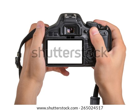 DSLR camera in hand isolated - stock photo
