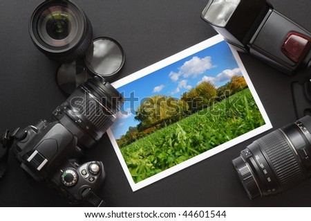 dslr camera lens and image on black background - stock photo