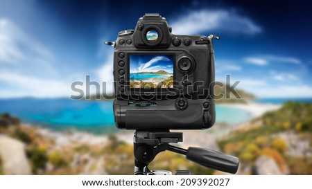 Dslr camera shooting on a beutiful seascape with blue sky - stock photo