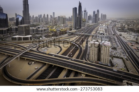 Dubai-April 14: Shiekh Zayed road conjunction near Burj Khalifa, the tallest building in the world on April 14,2015 in Dubai, UAE. - stock photo