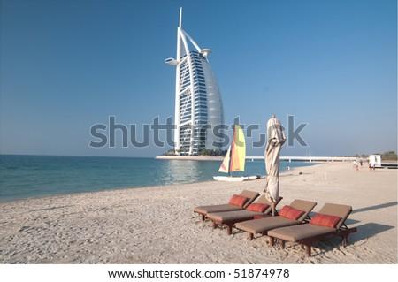 DUBAI - CIRCA APRIL 2010: View of the luxury beach of Dubai with the Burj al arab the most exclusive hotel of the world, and one of the few seven star, circa april 2010 in  Dubai - stock photo