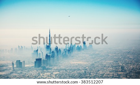Dubai city in sunrise aerial view - stock photo