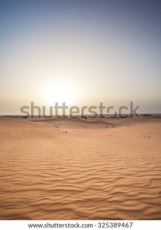 Dubai desert sand dunes at sunset - stock photo