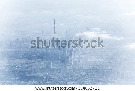 Dubai downtown in fog, beautiful misty cityscape, bad weather on luxury resort, UAE, vacation and travel concept - stock photo