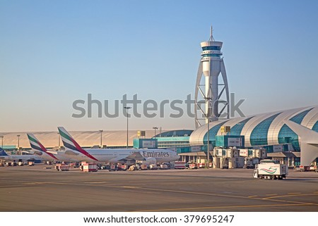Dubai - February 20:  Planes preparing for take off at Dubai Airport on February 20, 2016 in Dubai, U.A.E. Dubai airport is home port for Emirates Airlines and one of the biggest world hubs. - stock photo
