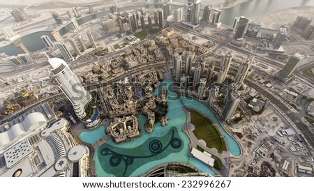 Dubai Fountain seen from the 148th floor of the Burj Khalifa Tower, 555 meters above sea level, the world highest outdoor observation deck. - stock photo