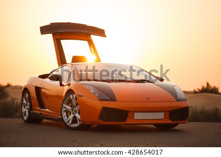 DUBAI, JANUARY 2014. Lamborgini car on a sunset   - stock photo
