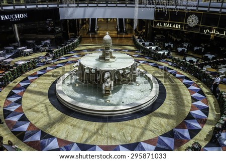 DUBAI - JULY 2015: A horse statue and fountain in Mall of the Emirates as seen on 11 July 2015. Indoor Sky Dubai is located in this mall. - stock photo