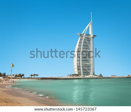 DUBAI - JUNE 4:  Burzh al Arab is well-known hotel on June 4, 2013 in Dubai. ?onstructed in the form of Dow's sail, the Arab vessel. Closer to top there is a helipad. Main sights of Dubai - stock photo