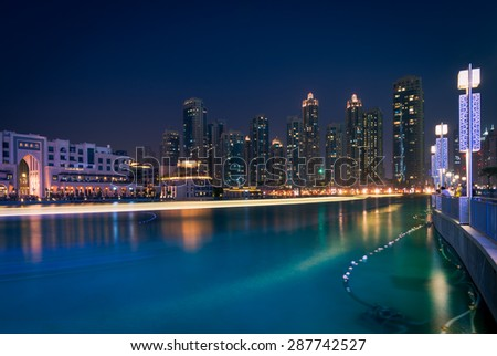 Dubai - June 4 : Dubai Fountain show area near Dubai mall, Souk Al Bahar,residential buildings  and Burj Khalifa the tallest building in the world on June 4,2015 in Dubai. - stock photo