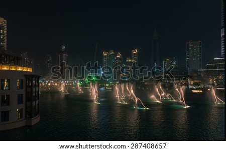 Dubai - June 4: Souk Al Bahar near Dubai mall, Dubai fountain and Burj Khalifa on June 4, 2015 in Dubai. - stock photo