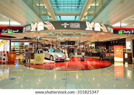 DUBAI - JUNE 23, 2015: The Dubai duty-free shopping area. Dubai International Airport is the primary airport serving Dubai and is the world's busiest airport by international passenger traffic - stock photo