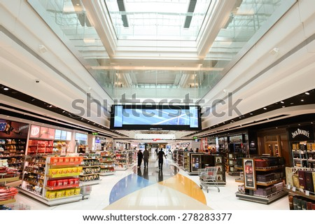 DUBAI - MARCH 10, 2015: The Dubai duty-free shopping area. Dubai International Airport is the primary airport serving Dubai and is the world's busiest airport by international passenger traffic - stock photo