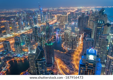 Dubai Marina and Jumeirah Lakes Towers at Blue hour. Glittering lights and tallest skyscrapers during a clear evening with Blue sky. - stock photo