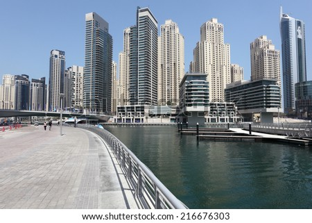 DUBAI MARINA, UAE - MAY 28: Waterfront promenade in Dubai Marina. May 28, 2011 in Dubai, United Arab Emirates  - stock photo