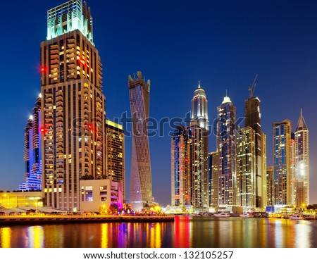 DUBAI MARINA, UAE - OCT 2: A night view of Jumeirah Beach Residence Towers on Oct 2, 2012 in Dubai, UAE. Dubai Marina is an artificial 3 km canal carved along the Persian Gulf shoreline - stock photo
