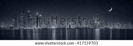 Dubai Marina under moon light - stock photo