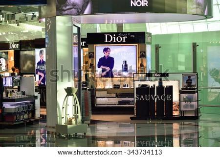 DUBAI - NOVEMBER 16, 2015: interior of Dubai Duty Free Level. Dubai Duty Free is the largest single airport retail operation in the world - stock photo