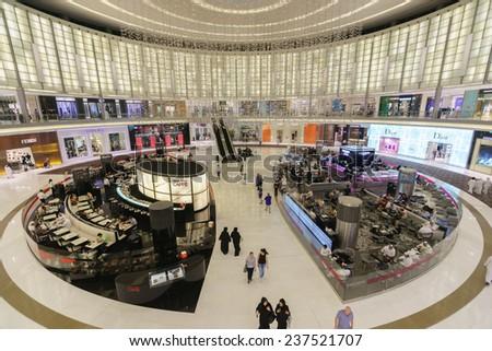 DUBAI - OCTOBER 15: The Dubai Mall interior on October 15, 2014 in Dubai, UAE. The Dubai Mall located in Dubai, it is part of the 20-billion-dollar Downtown Dubai complex, and includes 1,200 shops. - stock photo