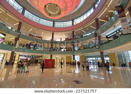 DUBAI - OCTOBER 15: The Dubai Mall linterior on October 15, 2014 in Dubai, UAE. The Dubai Mall located in Dubai, it is part of the 20-billion-dollar Downtown Dubai complex, and includes 1,200 shops. - stock photo