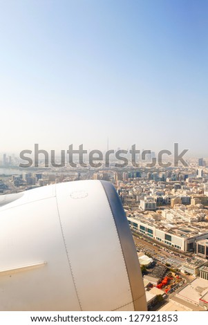 Dubai's skyscrapers and top view in sunny weather and aircraft engine - stock photo