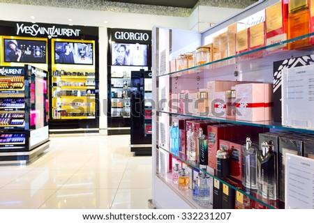 DUBAI - SEPTEMBER 08, 2015: interior of Dubai Duty Free. Dubai Duty Free is the largest single airport retail operation in the world - stock photo