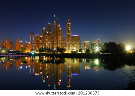 DUBAI, UAE - APR 20: Dubai, UAE: A cityscape view of Dubai Marina at dusk on Apr 20, 2014 in Dubai, UAE. Dubai Marina is an artificial 3 km canal carved along the Persian Gulf shoreline - stock photo