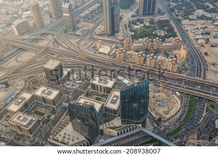 DUBAI, UAE - APRIL 29: Aerial view of Downtown Dubai and skyscrapers from the tallest building in the world, Burj Khalifa, at 828m, taken on 29 April 2013 in Dubai.  - stock photo