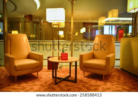 DUBAI, UAE - APRIL 18, 2014: airport interior. Dubai International Airport is a major international airport located in Dubai, and is the world's busiest airport by international passenger traffic. - stock photo