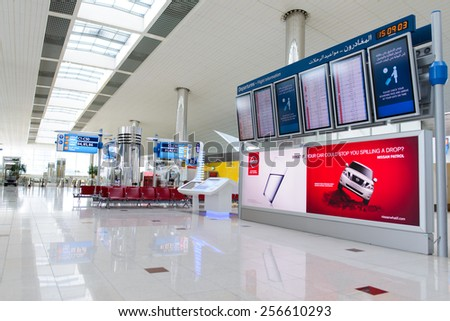 DUBAI, UAE - APRIL 18, 2014: airport interior. Dubai International Airport is an international airport serving Dubai. It is a major airline hub in the Middle East, and is the main airport of Dubai. - stock photo
