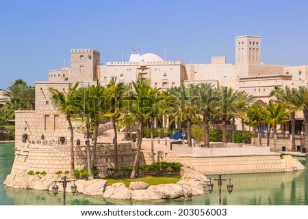 DUBAI, UAE - 1 APRIL 2014: Architecture of Madinat Jumeirah resort in Dubai, UAE. Madinat Jumeirah is 5 star resort in Dubai and the largest resort in the emirate with over 40 hectares of gardens. - stock photo