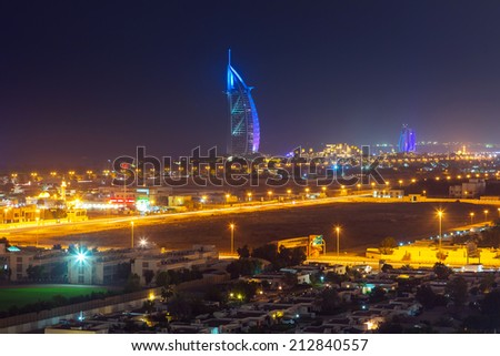 DUBAI, UAE - 3 APRIL 2014: Burj Al Arab hotel in Dubai at night, UAE. Burj Al Arab with 321 meters high is the most luxurious 7 star hotel and a symbol of modern Dubai. - stock photo