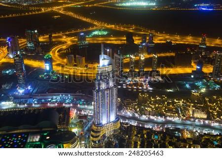 DUBAI, UAE -1 APRIL 2014: City centre scenery of Dubai at night, UAE. View from the 124 floor of Burj Khalifa - the tallest skyscraper in the world at 829.8m. - stock photo