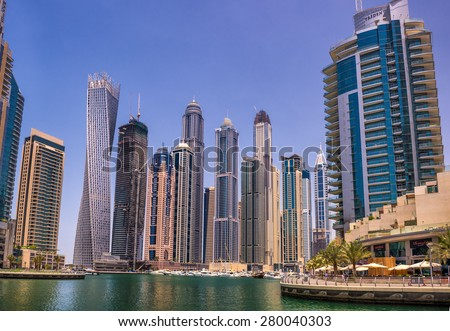 DUBAI, UAE - APRIL 29, 2015 : Modern buildings in Dubai Marina district. Marina is an artificial canal city built along Persian Gulf shoreline. - stock photo