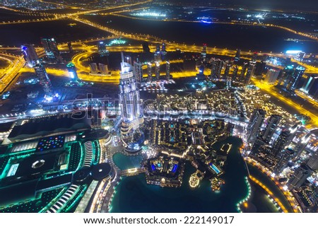 DUBAI, UAE - 1 APRIL 2014: Panorama of city centre in Dubai at night, UAE. View from the 124 floor of Burj Khalifa - the tallest skyscraper in the world at 829.8m. - stock photo