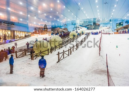 DUBAI, UAE - APRIL 6: Ski on April 6, 2013 in Dubai. Ski Dubai--is an indoor ski resort with 22,500 square meters of indoor ski area. It is a part of the Mall of the Emirates - stock photo