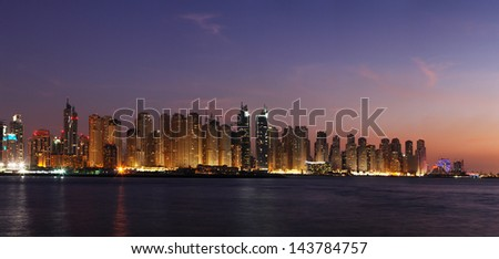 DUBAI, UAE - DEC 17: A night view of Dubai Marina including JBR - Jumeirah Beach Residence towers on Dec 17, 2010 in Dubai. This is the right side of a magnificent panorama seen from the Arabian Gulf - stock photo