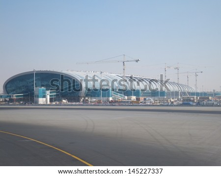 DUBAI, UAE - DEC 17: Dubai International Airport, one of the busiest airports, as seen on December 17, 2011. It is a major airline hub in the Middle East, and is the main airport of Dubai. - stock photo