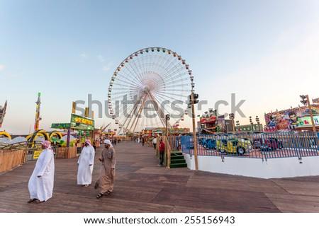 DUBAI, UAE - DEC 18: Ferris Wheel at the Global Village in Dubai. December 18, 2014 in Dubai, United Arab Emirates - stock photo
