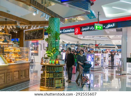 DUBAI, UAE - DEC 31: Glorious duty free shopping area in Dubai International Airport on Dec 31, 2014. Dubai International is the world's busiest airport in terms of international passenger traffic. - stock photo