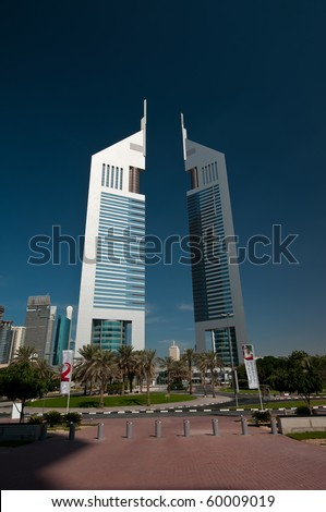 DUBAI, UAE - DEC 04: The iconic Emirates Towers of Dubai taken on Dec 4, 2009 in Dubai.  One of the two towers is a hotel and the other is an office building with a Boulevard of shops and restaurants. - stock photo